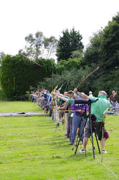 Longbow archer's arrow leaving bow at the Surrey Clout championships